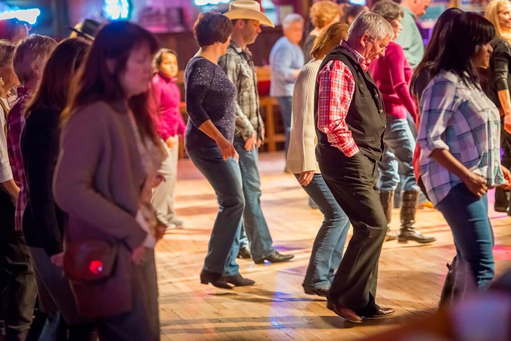 group-of-people-line-dancing